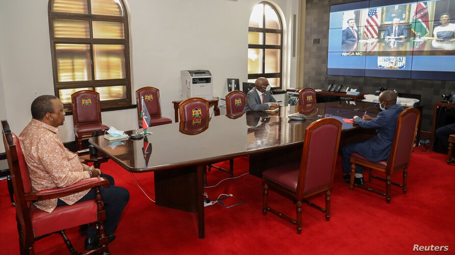 Kenya's President Uhuru Kenyatta witnesses the virtual launch of the Kenya-United States Free Trade Agreement (FTA)…