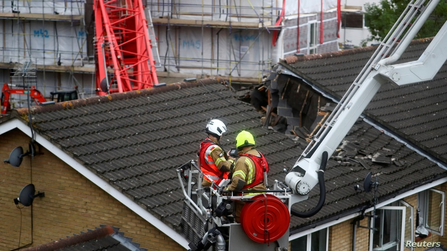 Rescue personnel work at the area where a crane collapsed in Bow, east London, Britain, July 8, 2020. REUTERS/Hannah McKay