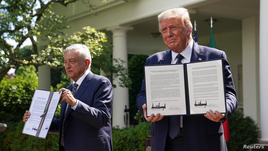 U.S. President Donald Trump holds a joint declaration he signed with Mexico's President Andres Manuel Lopez Obrador in the Rose…