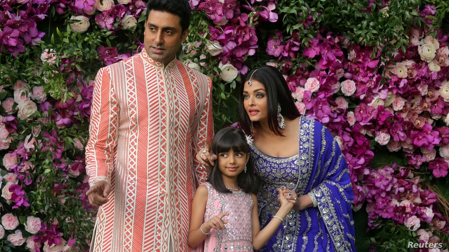 FILE PHOTO: Indian film actor Abhishek Bachchan, his wife Aishwarya Rai and their daughter Aaradhya in a 2019 photograph taken…