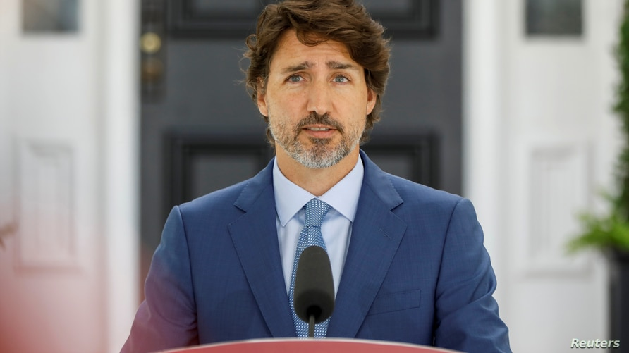 Canada's Prime Minister Justin Trudeau attends a news conference at Rideau Cottage, as efforts continue to help slow the spread…