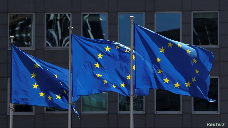 FILE PHOTO: European Union flags flutter outside the European Commission headquarters in Brussels, Belgium June 25, 2020…