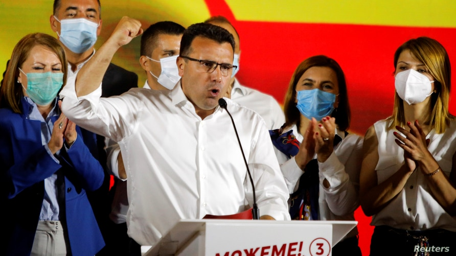 Macedonian Former Prime Minister and leader of the ruling SDSM party Zoran Zaev celebrates his victory in a parliamentary…