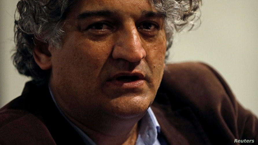 Matiullah Jan, a journalist and columnist, reacts during an interview with Reuters at his office in Islamabad, Pakistan March…