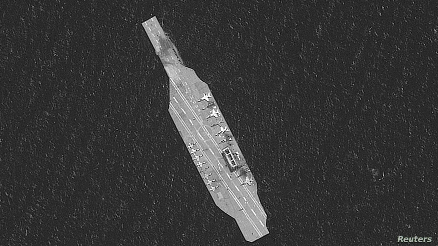A closeup of the Iranian mockup aircarft carrier is seen in this satellite image collected over the Strait of Hormuz July 28,…