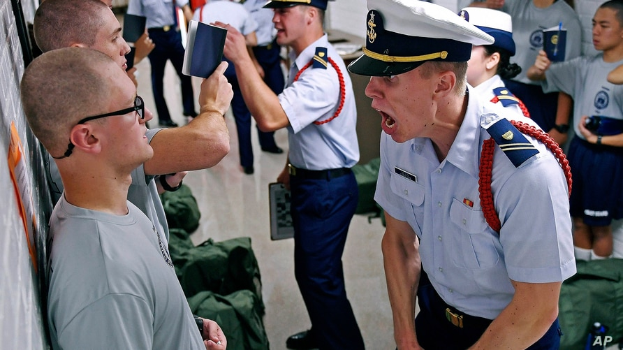 FILE - Whisky 2 company Cadre Jacob Denns, right, shouts instructions to swab Nicolas Fisher