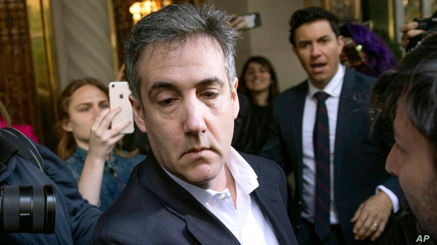 FILE - Michael Cohen, former attorney to President Donald Trump, leaves his apartment building.