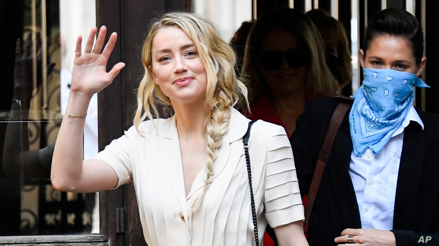 Amber Heard arrives at the High Court, in London, Monday, July 20, 2020.