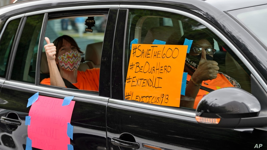 Motorists take part in a caravan protest in front of Senator John Kennedy's office at the Hale Boggs Federal Building