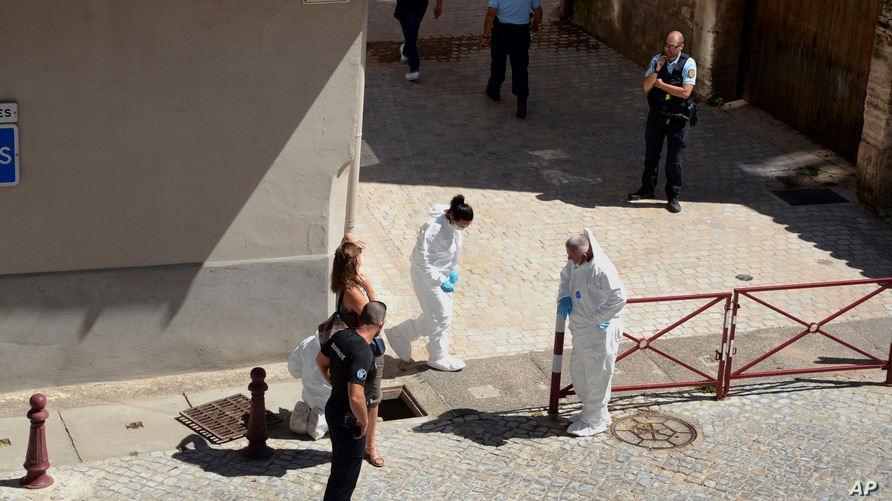 French police stand next a storm drain where the body of Laure Bardina-Kruger was found, in Peyriac de Mer, southern France,…