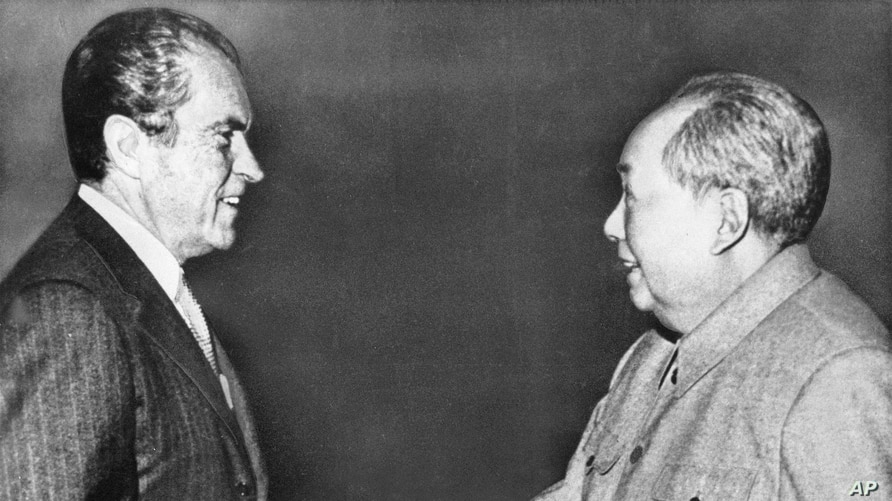 ** FILE** In this Feb 21, 1972 file photo, U.S. President Richard M. Nixon, left, shakes hands with Chinese communist party…
