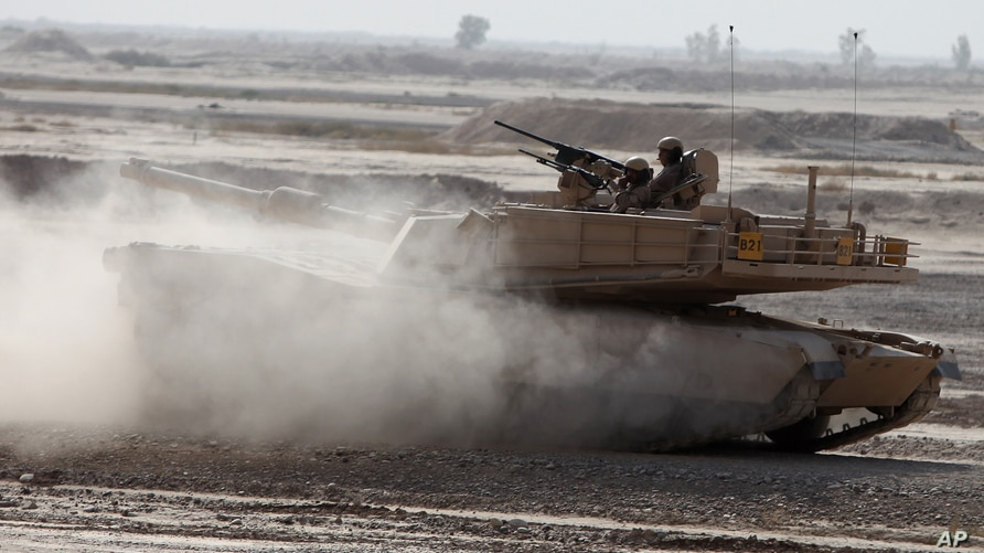 Iraqi Army soldiers in a M1A1 Abrams tank, purchased from the U.S., participate in joint training with U.S. troops at the…