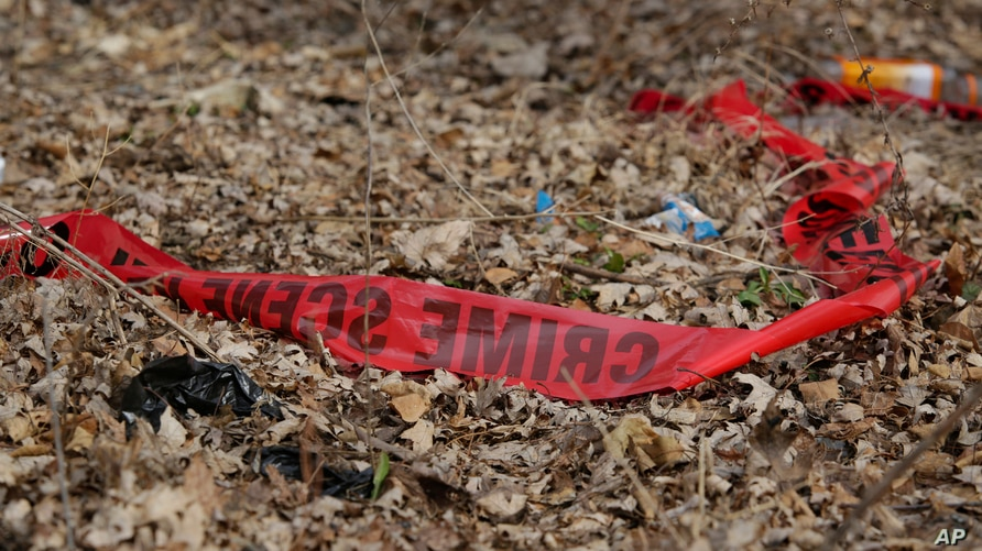 In this Feb. 15, 2017 photo, police tape litters the ground at the scene of a Feb. 14, shooting that killed a toddler and a man authorities say was the intended target in Chicago, Ill.