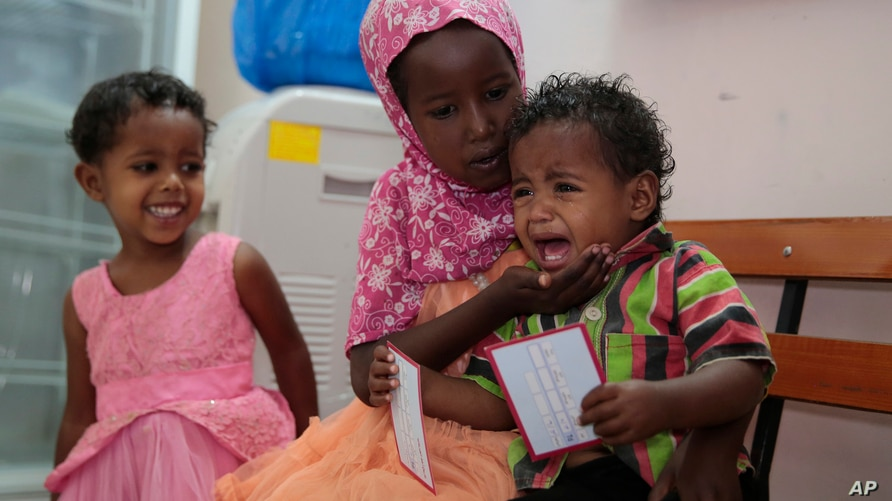 A boy cries after receiving a diphtheria shot during a vaccination campaign, in Sanaa, Yemen, Sunday, May 13, 2018. (AP Photo…