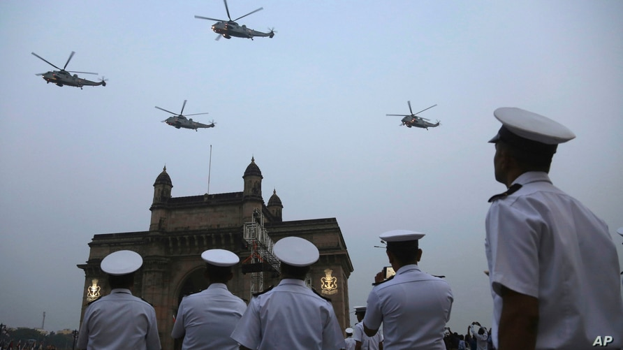FILE - Indian navy personnel display their skills during a rehearsal for Naval Day celebrations in Mumbai, India.