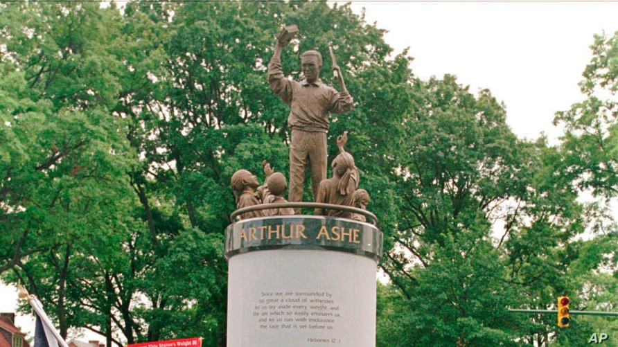 FILE - In this July 10, 1996 file photo, a crowd gathers at the base of the Arthur Ashe Monument after the ceremony dedicating…