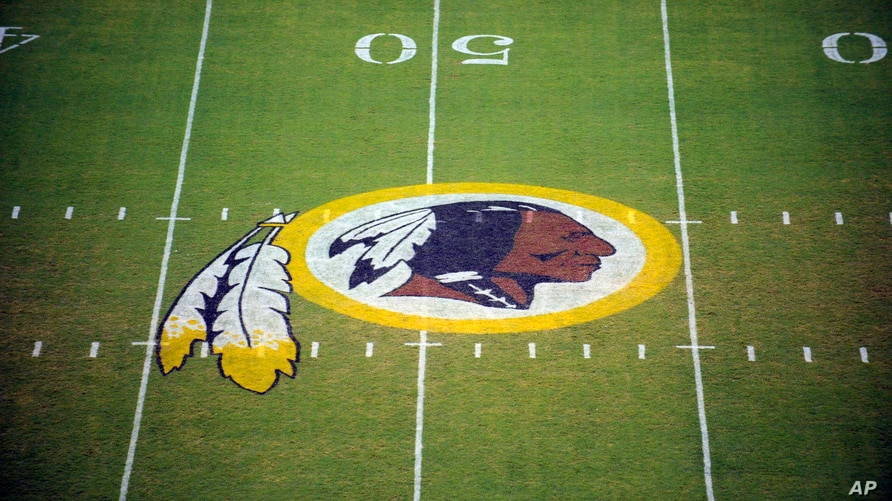 FILE - The Washington Redskins logo is shown on the field before the start of a preseason NFL football game against the New England Patriots in Landover, Md.