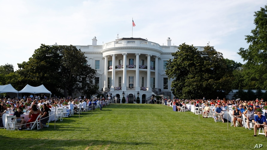 """Guests wait for President Donald Trump and first lady Melania Trump during a """"Salute to America"""" event on the South Lawn of the White House, Saturday, July 4, 2020, in Washington. (AP Photo/Patrick Semansky)"""
