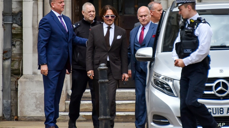 Johnny Depp, center, leaves the High Court, in London, Friday, July 10, 2020.