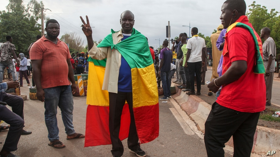 Anti-government protesters demonstrate in the capital Bamako, Mali Friday, July 10, 2020. Thousands marched Friday in Mali's…