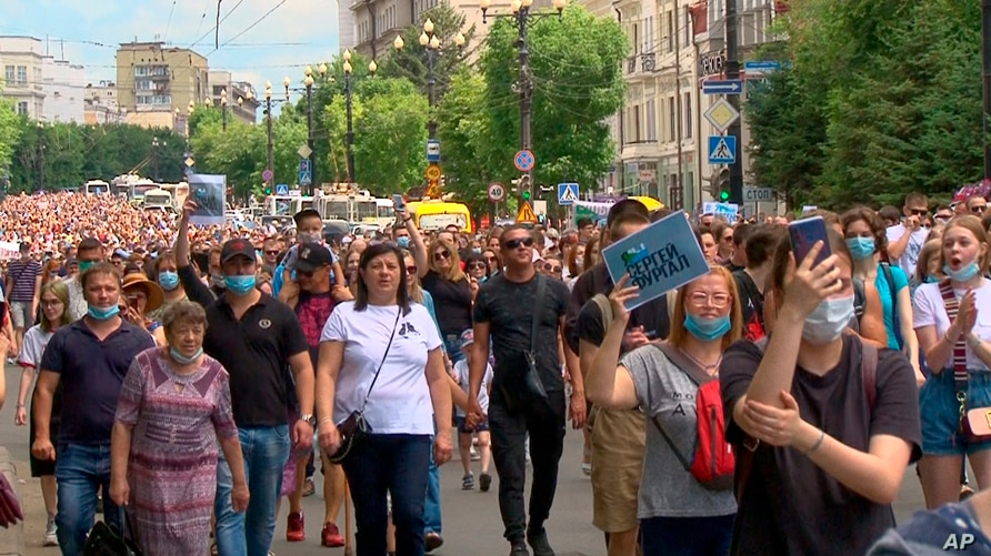 People attend a protest in support of Sergei Furgal, the governor of the Khabarovsk region, who was arrested in Khabarovsk Thursday and flown to Moscow for interrogation, in Khabarovsk, Russia, July 11, 2020.