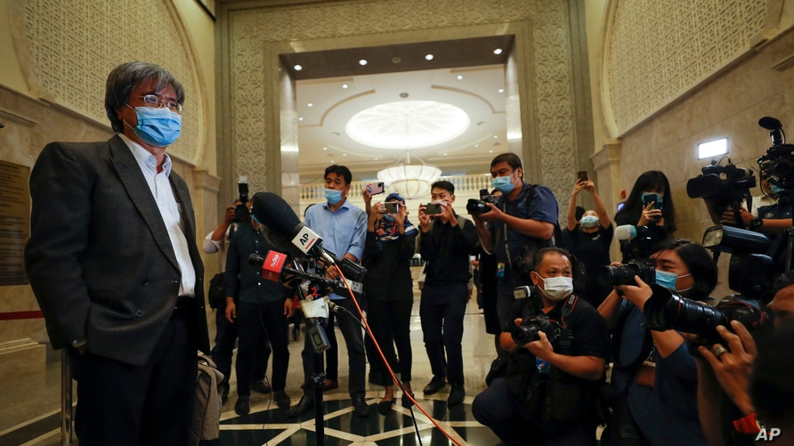 FILE - Steven Gan, left, editor-in-chief of Malaysiakini online news portal, arrives at court in Putrajaya, Malaysia, July 13, 2020.