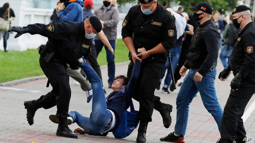 Police officers detain a protester during a rally against the removal of opposition candidates from the presidential elections in Minsk, Belarus, July 14, 2020.