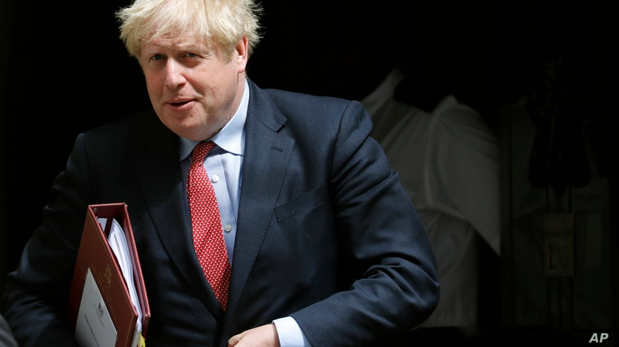 Britain's Prime Boris Johnson leaves 10 Downing Street to attend the weekly Prime Minister's Questions session, in parliament in London, July 15, 2020.