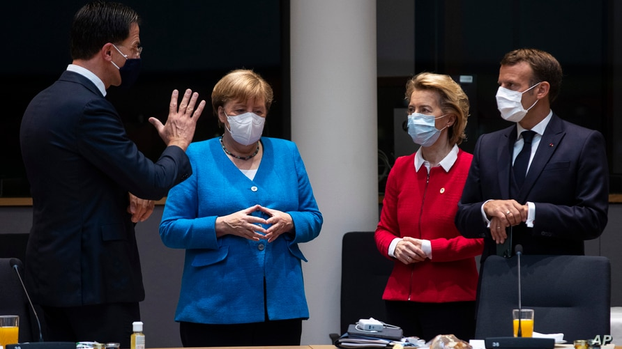 From left, Dutch Prime Minister Mark Rutte, German Chancellor Angela Merkel, European Commission President Ursula von der Leyen and French President Emmanuel Macron speak during a meeting on the sidelines of an EU summit in Brussels, July 18, 2020.