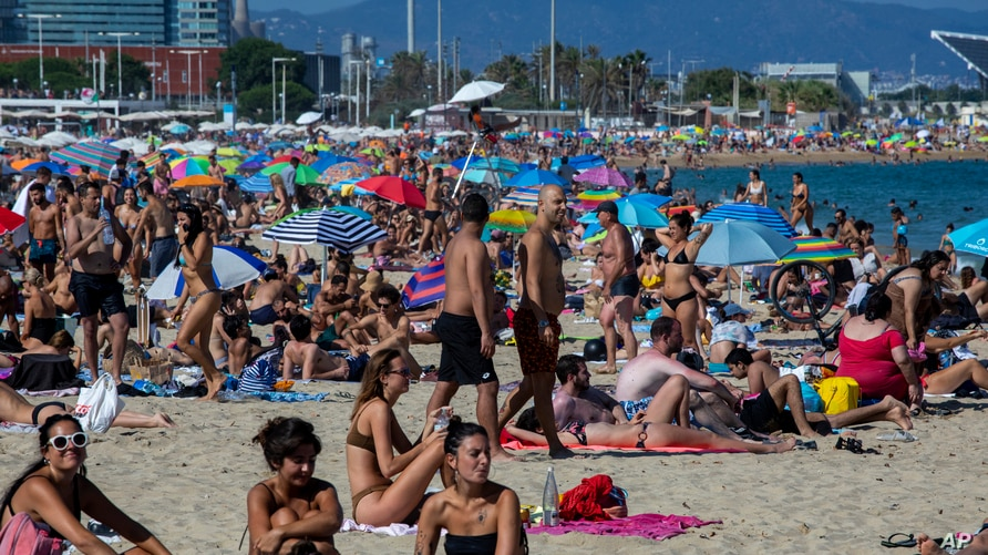 People enjoy the beach in Barcelona, Spain, July 18, 2020.