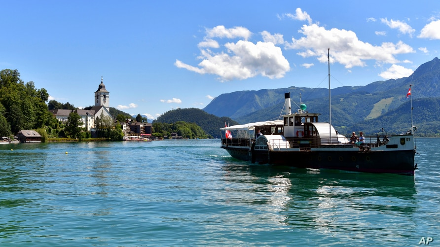 A pleasure boat is seen at the lake Wolfgangsee in St. Wolfgang, Austria, Monday, July 27, 2020 .More than 50 corona tests in…
