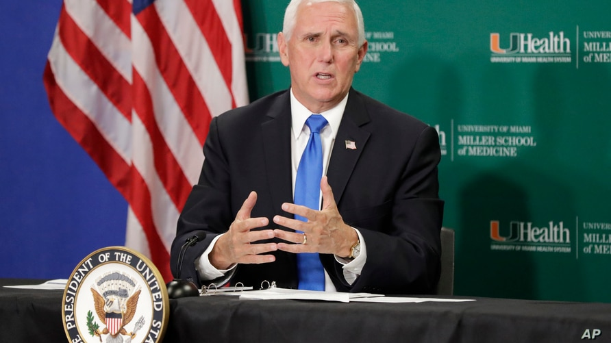Vice President Mike Pence speaks as he participates in a roundtable discussion at the University of Miami Miller School of Medicine