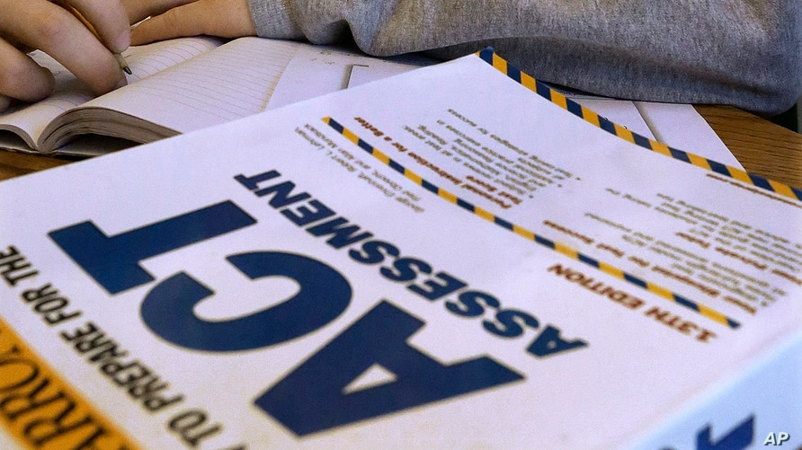 FILE - This April 1, 2014 file photo shows an ACT Assessment test in Springfield, Ill. The popular ACT college admissions exam…