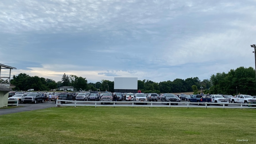 Haar's Drive-In Theater parking lot as customers wait for movie to begin.