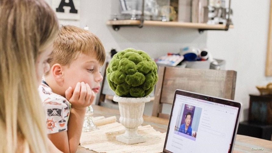 Mom uses telemedicine to talk with Dr. William Chu, medical director of the NightLight Pediatric Urgent Care clinics, Houston, T