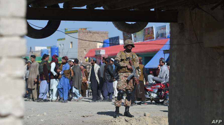 FILE - A Pakistani army soldier stands guard at a market in Miran Shah, a town in North Waziristan, near the border between Pakistan and Afghanistan, Jan. 27, 2019.