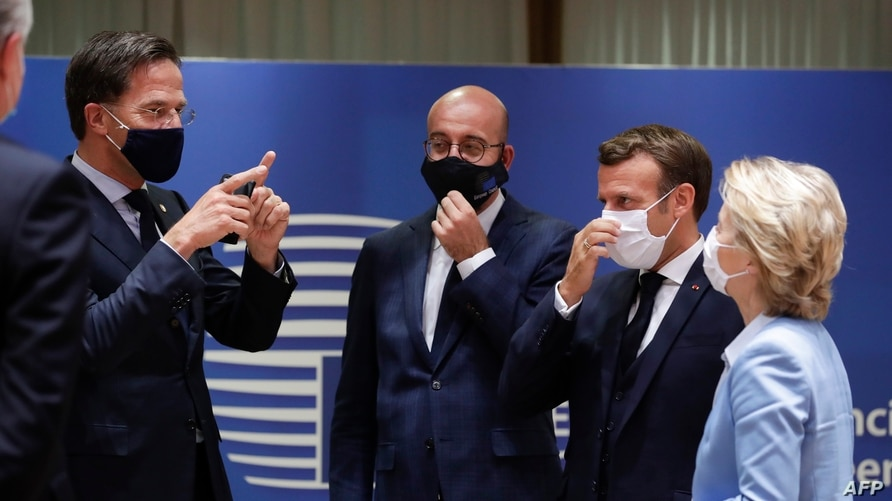 Left to right, Dutch Prime Minister Mark Rutte, European Council President Charles Michel, French President Emmanuel Macron and President of the European Commission Ursula von der Leyen chat at a European Union summit in Brussels, Belgium, July 21, 2020.