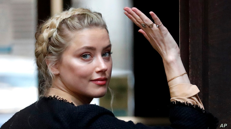 American actress Amber Heard arrives at the High Court in London in London, July 22, 2020.
