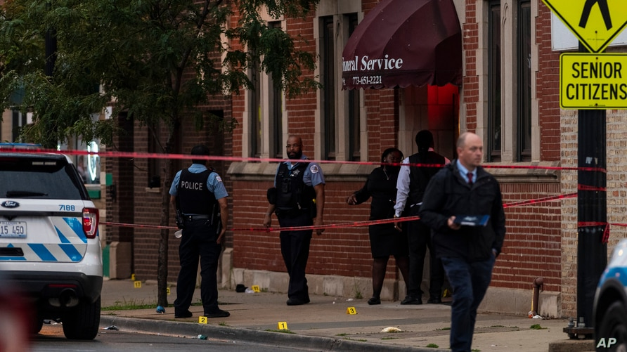 Chicago police investigate the scene of a mass shooting where more then a dozen people were shot in the Gresham neighborhood, July 21, 2020. (Credit: Tyler LaRiviere/Chicago Sun-Times)