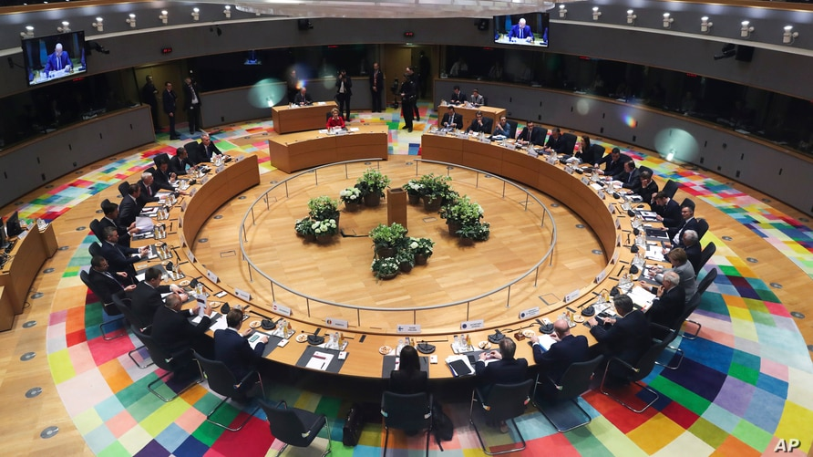 FILE - European Union leaders meet at a roundtable during an EU summit in Brussels, Belgium, Feb. 21, 2020.