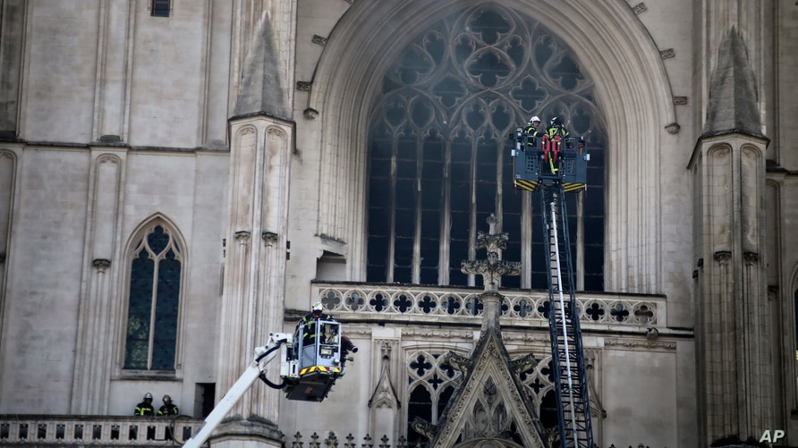Fire fighters brigade work to extinguish the blaze at the Gothic St. Peter and St. Paul Cathedral, in Nantes, western France, July 18, 2020.