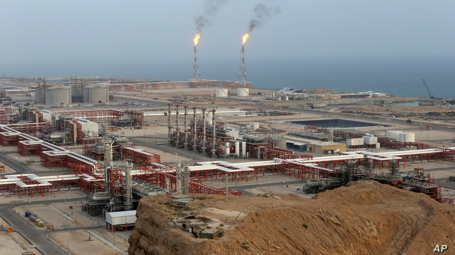 FILE - Natural gas refineries are seen at the South Pars gas field on the northern coast of the Persian Gulf, in Asaluyeh, Iran, March 16, 2019.