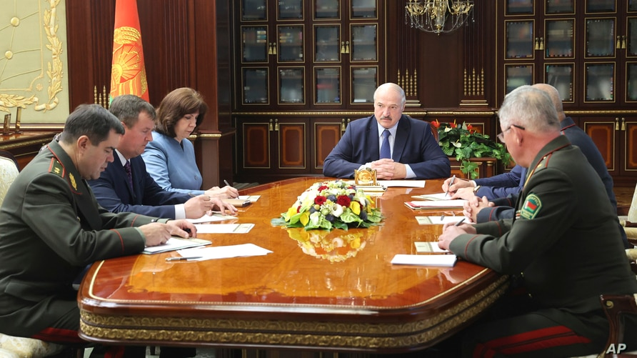 Belarusian President Alexander Lukashenko, center, chairs a meeting of the country's Security Council, in Minsk, Belarus, July 29, 2020.