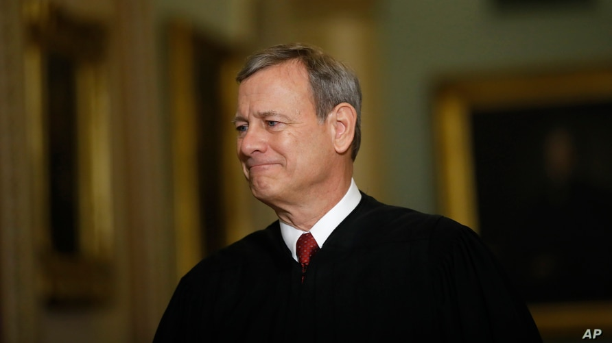 FILE - Chief Justice of the United States John Roberts walks to the Senate chamber at the Capitol in Washington, Jan. 16, 2020.
