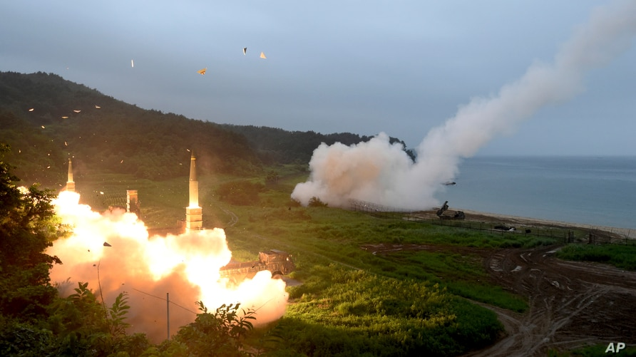FILE - A photo provided by South Korea's Defense Ministry shows the country's Hyunmoo II Missile System fire a missile during a military exercise at an undisclosed location in South Korea, July 29, 2017.