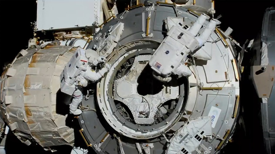 NASA spacewalkers (from left) Bob Behnken and Chris Cassidy set up the outside of the Tranquility module for the future installation of the NanoRacks airlock. (Credit: NASA)