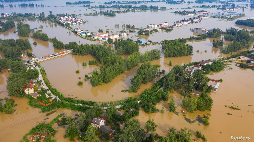 An aerial view shows a flooded town in China's Anhui province, July 20, 2020. (China Daily via Reuters)