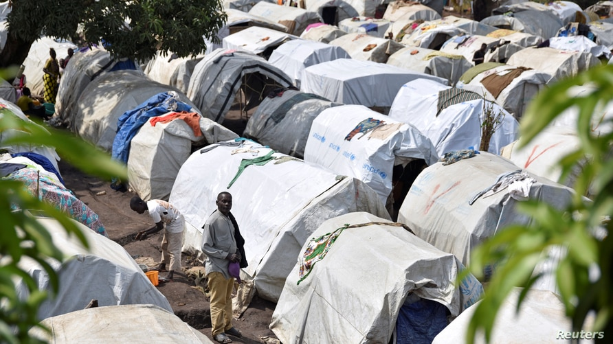 FILE - Victims of ethnic violence are seen at a makeshift camp for internally displaced people, in Bunia, Ituri province, in the eastern Democratic Republic of Congo, June 25, 2019.