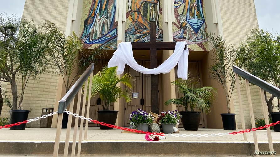 The front doors to a Catholic church are chained off on Easter Sunday, in Long Beach, California, April 12, 2020.