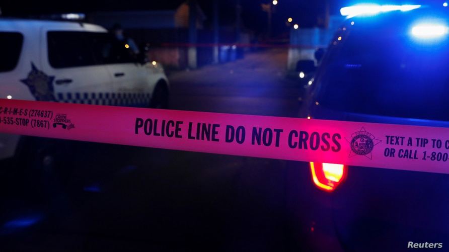 Chicago police crime scene tape marks the crime scene of a shooting of two men at the South Side of Chicago, Illinois, July 25, 2020.